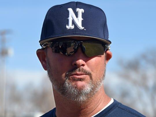 Nevada softaball head coach Josh Taylor talks to the