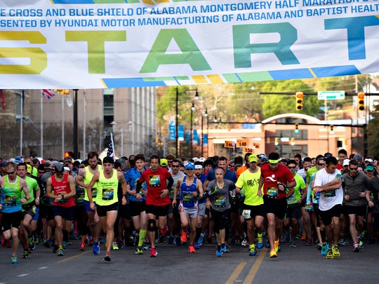 Runners take off at the start of the Montgomery Half Marathon during the Montgomery Half Marathon and 5k race on Saturday, March 11, 2017, in Montgomery, Ala.
