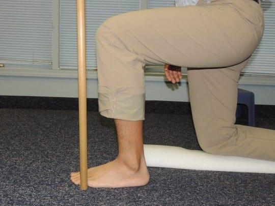 half kneel ankle mobilization (start position)