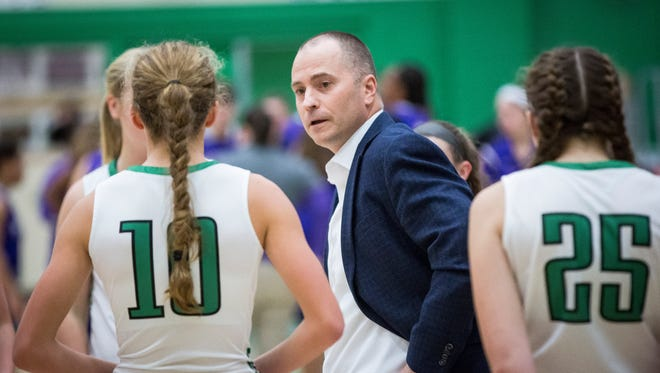 Yorktown's coach Jamie Matthews talks to the team during a timeout at the home game Tuesday night at Yorktown High School. Yorktown won the game 37-31.
