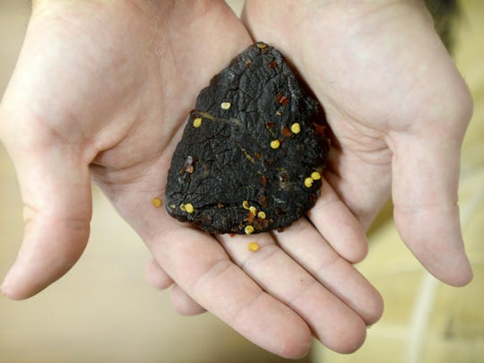 The Beef Jerky Outlet at the Asheville Outlets sells a variety of jerky, including Sweet and Spicy Smoky Mountain Traditional beef jerky, as well as other food items like dried fruits and novelty items made with insects.