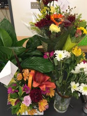 Flowers offered by the Simi Valley community are seen inside the school office of Vista Elementary on Monday.