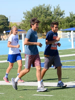 Carlsbad's Jensen Leivo, Micah Calderon (center) and Malachi Calderon wrap up their training during Tuesday's practice. The boys and girls track teams will be Albuquerque Friday and Saturday for the 6A state championships.