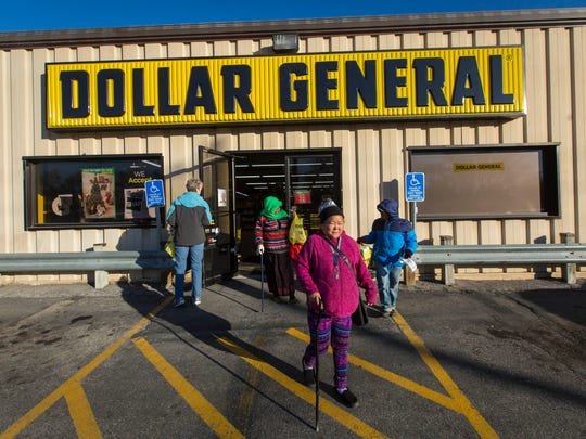 Rupa, Priti, Badu Rai leave the Dollar General Store along 63rd Street in Des Moines after getting groceries Wednesday, Dec. 6, 2017. It is over a mile and a half from their apartment to the nearest grocery store with out public transportation.