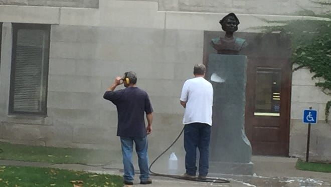 A statue of Christopher Columbus outside of the Broome County Courthouse in Downtown Binghamton is cleaned Tuesday morning after being vandalized a second time in a month.