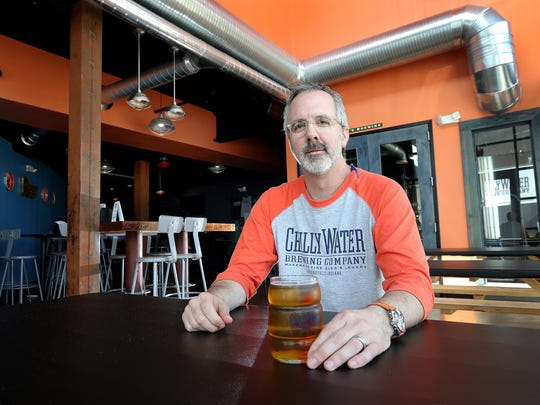 Skip DuVall, the owner of Chilly Water Brewing Co., 719 Virginia Ave, with one of  his craft brews.