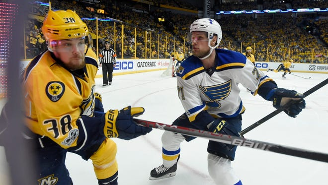 Predators right wing Viktor Arvidsson (38) and Blues center Vladimir Sobotka (71) go into the boards during the second period of Game 3 on Sunday, April 30, 2017.