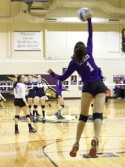 Jumping up for the ball Friday is PCA's Olivia Mady.