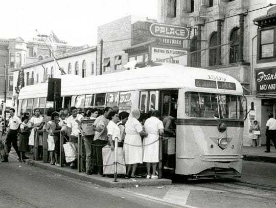 People wait in line to board the El Paso streetcar