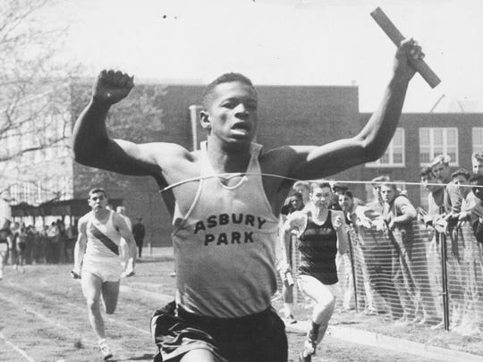 Frank Budd celebrates a victory in 1958.