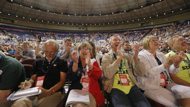 Delegates are shown cheering at the 2014 Texas Republican Convention. This year the party plans to hold its state convention in Houston, one of the epicenters of the coronavirus outbreak.