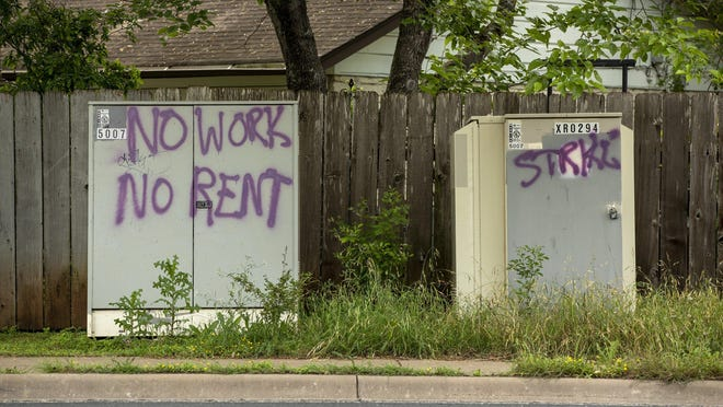 Graffiti calling for a rent strike during the coronavirus pandemic was left on West Gate Boulevard on April 21. The city of Austin has approved a $17.5 million package to aid renters affected by the pandemic.