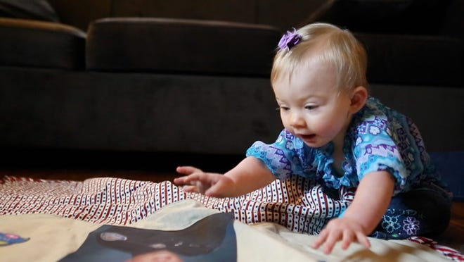 """Charity Pierson spends """"da-da"""" time with a baby blanket, pictured above and below, that has a photo of her late father, Daryl Pierson, on it. Charity's mother, Amy Pierson, says Charity spends time with his picture every day."""