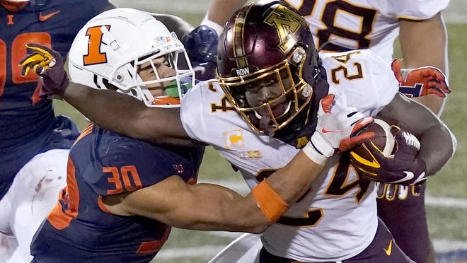Minnesota running back Mohamed Ibrahim (24) carries the ball against Illinois defender Sydney Brown on Saturday in Champaign, Ill.