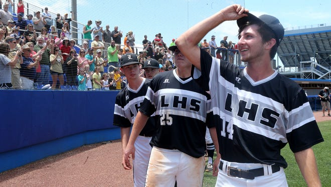 Loretto players Ethan Lyle (25) and Jacob Hallmark (14) recognise the fans with the rest of the team after beating Goodpasture during the Class A Baseball State Championship at Spring Fling on Friday, May 26, 2017.