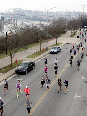 Runners make their way up Gay Street at the start of the Music City Half Marathon and 10K Sunday.