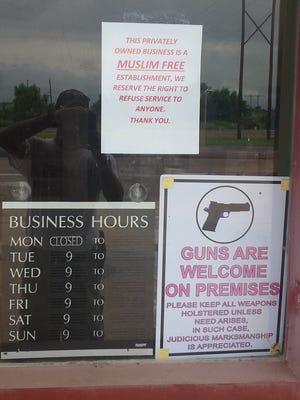 "A sign on the door of a survival-gear store in Oktaha, Okla., declares the establishment as ""Muslim-free."""