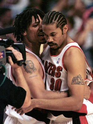 Portland Trail Blazers' Rasheed Wallace, right, and Brian Grant hug as they celebrate a 92-80 victory over the Utah Jazz to win the second round of NBA playoffs in Portland, Ore., Thursday, May 27, 1999. Portland now advances to the Western Conference finals against San Antonio.