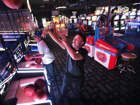 James Little, right, and James Curry shoot some hoops in the arcade at Memphis' first Dave & Buster's on Wolf Creek Parkway during a day of training for employees of the new arcade and sports bar. Dave & Buster's opens Monday, Feb. 12, 2018.