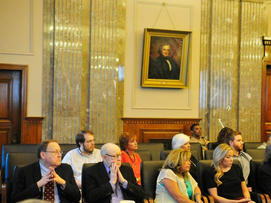 Lindsey Lowe's father, grandfather, mother and sister listen to lawyers testify during an appeal Tuesday, Aug. 11, 2015, in the Court of Criminal Appeals.