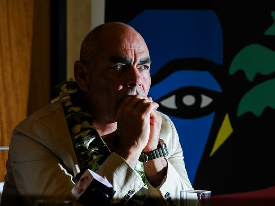 Author and poet Jimmy Santiago Baca, right, gathers his thoughts before responding to a question during a press conference with at the Westin Resort Guam in Tumon on Monday, Oct.12.