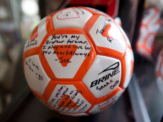 A soccer ball signed by Ian Hartley's friends and teammates on Thursday, May 12, 2016 at his mother's apartment in Charlotte. Ian jumped from a highway overpass May 2.