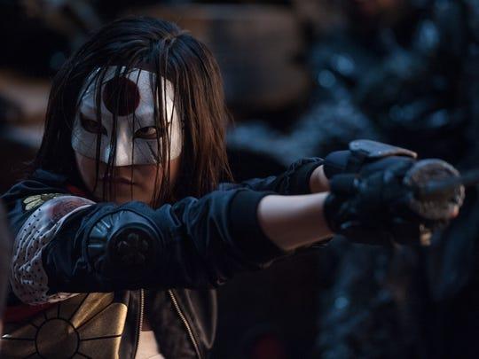 Katana (Karen Fukuhara) wields a blade that has the