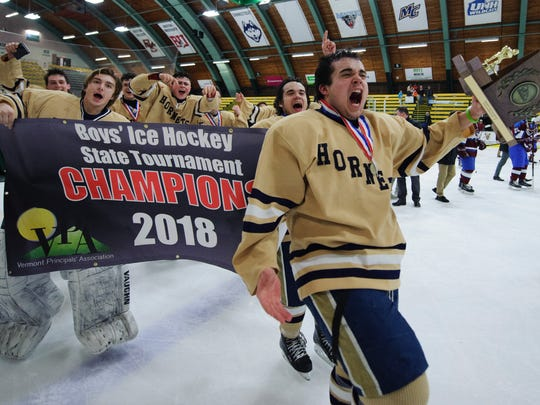 Essex celebrates the championship during the Vermont state Division I boys hockey championship game between Spaulding and Essex at Gutterson Fieldhouse on Monday evening March 19, 2018 in Burlington.