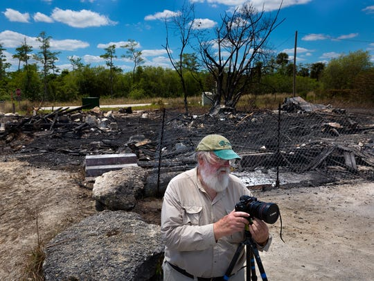 Acclaimed Everglades photographer Clyde Butcher sets up to photograph the smoldering ruins of the historic Monroe Station on Sunday, April 10, 2016, in Ochopee.  A fire destroyed the historic way station on the Tamiami Trail between Naples and Miami on Saturday night. It was one of a series of way stations built in the late 1920s after the opening of  the Tamiami Trail to help travelers.