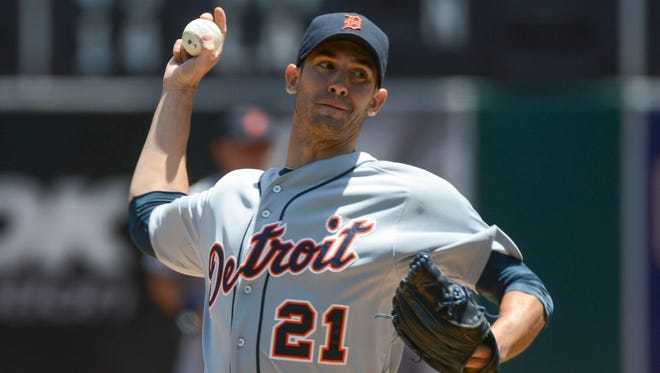 Tigers starting pitcher Rick Porcello delivers a pitch against the Athletics during the first inning at O.co Coliseum.