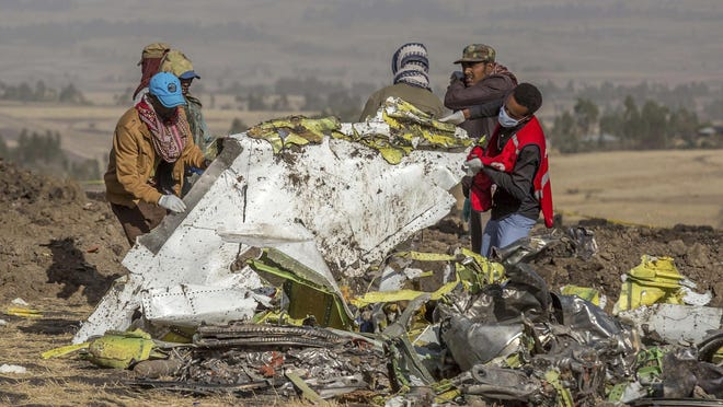 Rescuers work at the scene of an Ethiopian Airlines flight crash near Bishoftu, or Debre Zeit, south of Addis Ababa, Ethiopia, March 11, 2019.