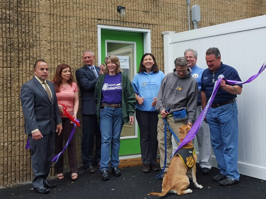 Members of the Yorktown Chamber of Commerce and Town Council, co-owners Elissa Cohen and Lisa Smith, Tom White of Paws Crossed and pooch Chips were among those at the opening.