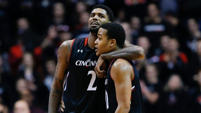 Cincinnati Bearcats forward Octavius Ellis (2), left, and Cincinnati Bearcats guard Troy Caupain (10) embrace in the second half during the NCAA basketball game between the Southern Methodist Mustangs and the Cincinnati Bearcats, Sunday, March 6, 2016, at Fifth Third Arena in Cincinnati. Cincinnati defeated SMU 61-54.