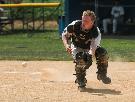New Oxford catcher Austin Roth moves to catch a ground