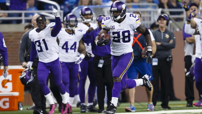Minnesota Vikings running back Adrian Peterson (28) breaks down field for a 75-yard run during the second half of the Oct. 25 game against the Detroit Lions in Detroit.
