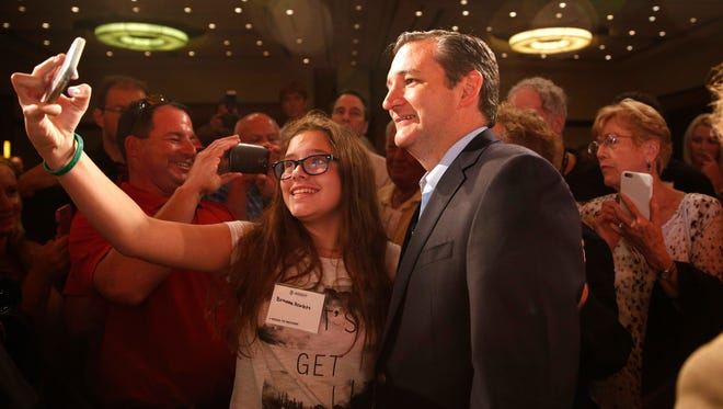 Sen. Ted Cruz, right, R-Texas, poses for a photo after speaking at the Americans for Prosperity Road to Reform event Aug. 14, 2015, in Las Vegas.