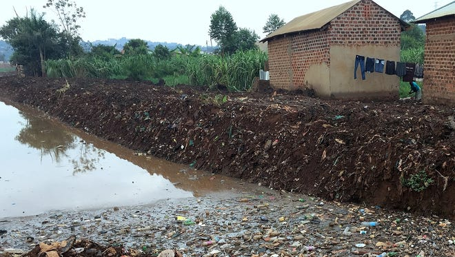 Students at Treasured Kids School in Uganda often drink dirty water from this open canal near the school.