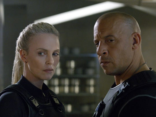 """Charlize Theron, left, and Vin Diesel appear in a scene from """"The Fate of the Furious."""""""