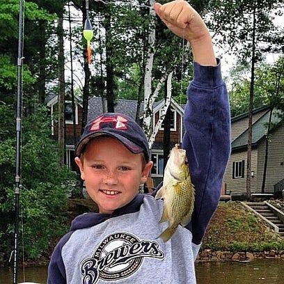 Joel DeBoer's newest fishing buddy, proudly displaying a summertime rock bass.
