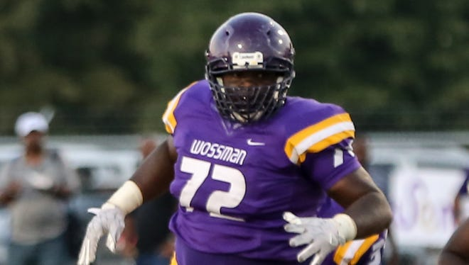 Hutchinson (72) was a member of the Wossman football team during during his freshman and sophomore years at the school.