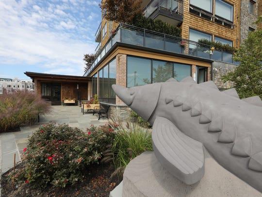 A sculpture of a sturgeon sits near The Hudson Farmer
