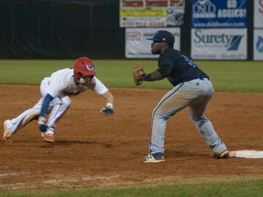 Pine Forest's Riley White dives back into first base