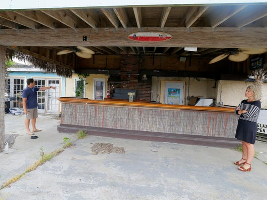 Scott and Amy Kelly, owners of Mad Hatter in Sea Bright, tour the property, which was destroyed by Sandy, Friday June 3, 2016. The owners will go before the planning board for the ninth time to finally get approval to start the rebuild later this month. They talk about the back patio bar, which reopened duirng the summers of 2013 and 2014.