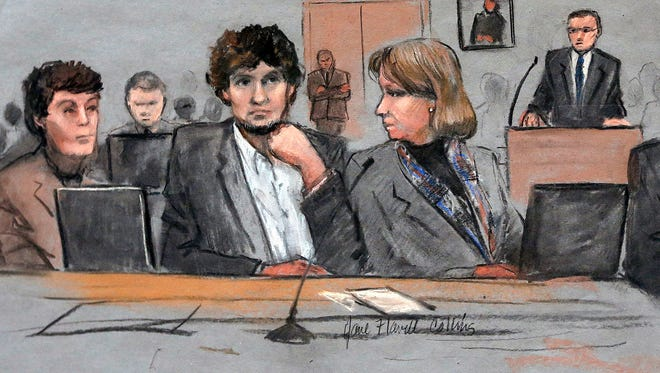 FILE - In this March 5, 2015 file courtroom sketch, Dzhokhar Tsarnaev, center, is depicted between defense attorneys Miriam Conrad, left, and Judy Clarke, right, during his federal death penalty trial in Boston.  Prosecutors rested their case against Tsarnaev on Monday, March 30, 2015, after jurors saw gruesome autopsy photos and heard a medical examiner describe the devastating injuries suffered by the three people who died in the 2013 terror attack. (AP Photo/Jane Flavell Collins, File) ORG XMIT: BX101