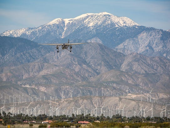 Nearly 3,000 people that have worked for Airport Terminal Services in California are eligible for payment through the settlement of a class action lawsuit brought against the company by three workers in Palm Springs. In this file photo, a historic plan comes in for a landing at Palm Springs International Airport.