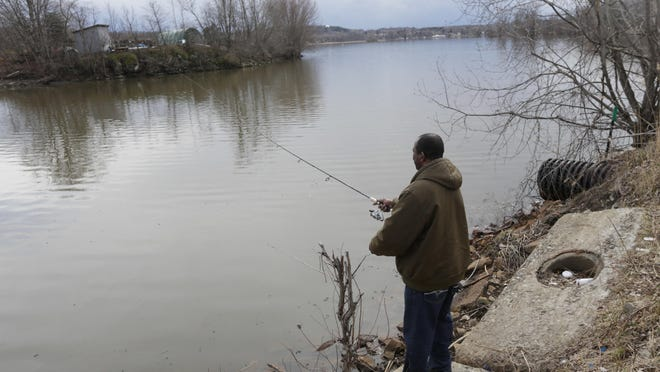Milton Berrien fishes on the Mohawk River on Thursday in Halfmoon, N.Y.