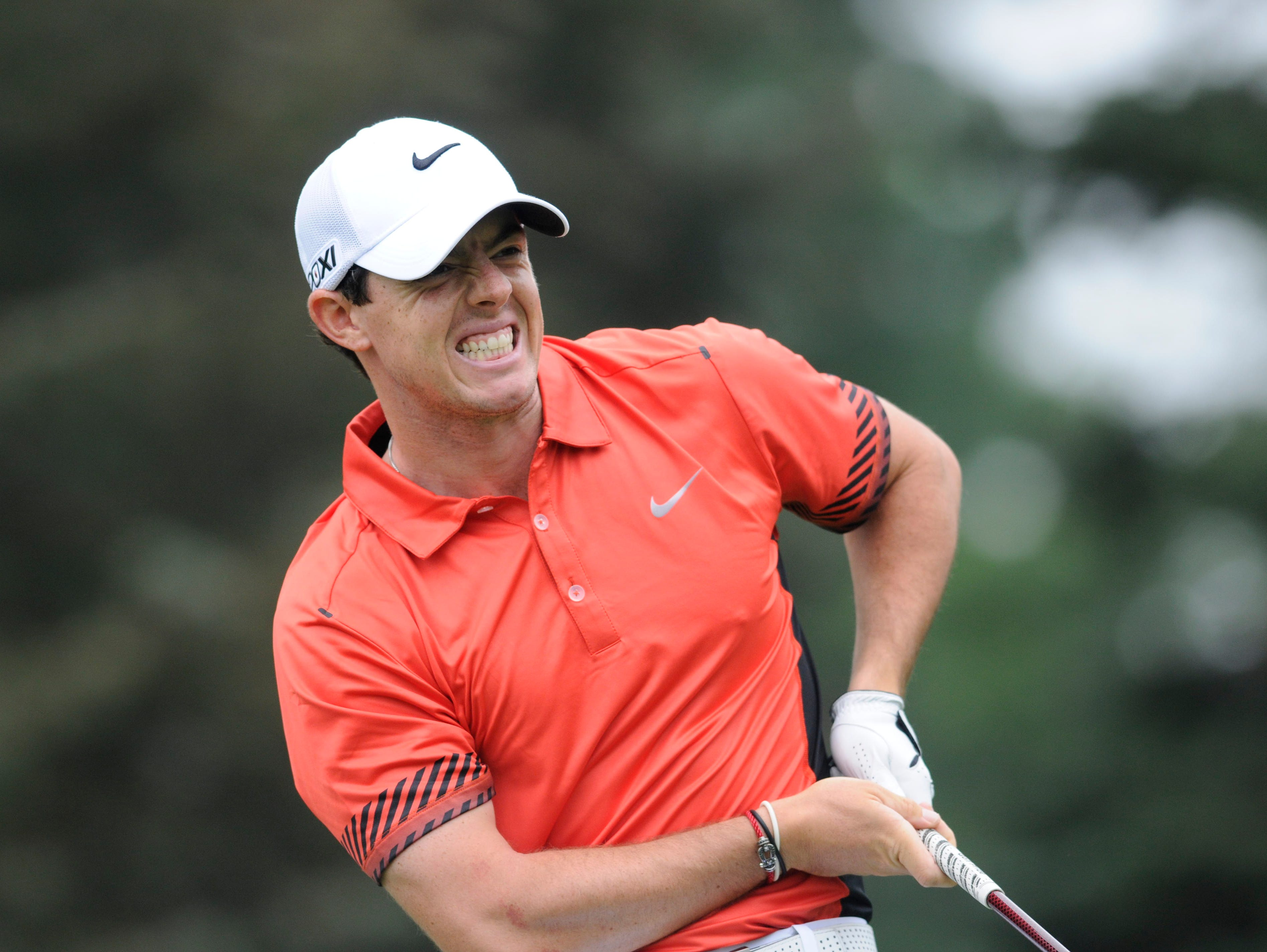 Rory McIlroy grimaces after his tee shot on the 7th hole.
