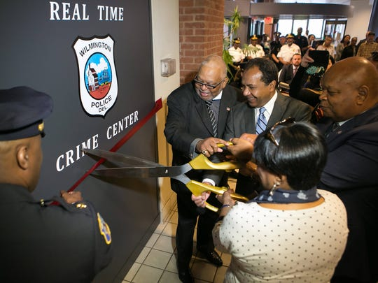 Police Chief Bobby Cummings, Mayor Dennis Williams and other city officials cut the ceremonial ribbon as they unveil the Real Time Crime Center, a key recommendation given last year by the state Public Safety Strategies Commission.