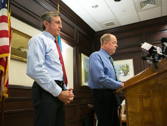 Gov. John Carney (left) and former U.S. Attorney Charles