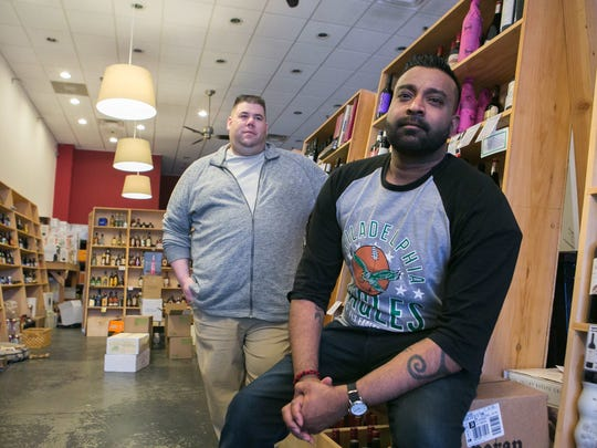 Venu Gaddamidi (right), owner of Veritas Wine & Craft Beer at the Wilmington Riverfront, has teamed with former Moro restaurant owner Michael DiBianca to create a small bistro, which is now open.